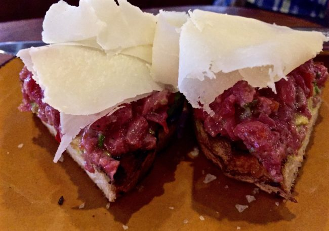 Filet Mignon Tartare; avocado, Fresno chile pepper, capers, shallot, parmigiana on grilled bread ($16)